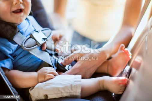 istock Baby and Mother Strapping in Carseat 168325143