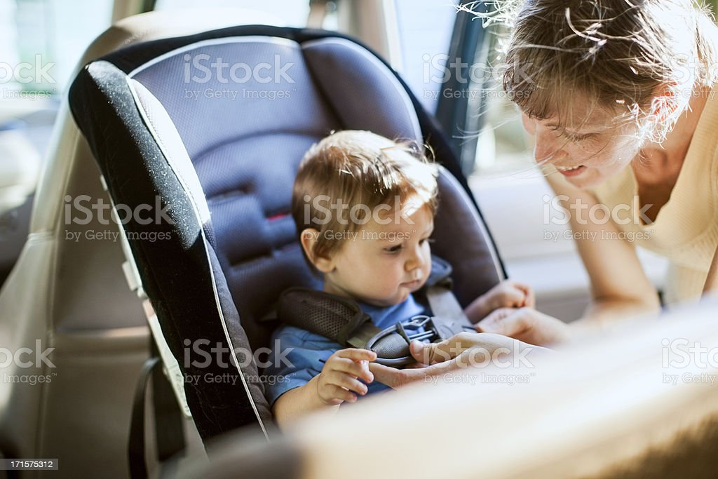 Baby and Mother Strapping in Carseat stock photo
