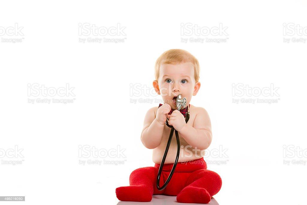 Baby and Stethoscope stock photo
