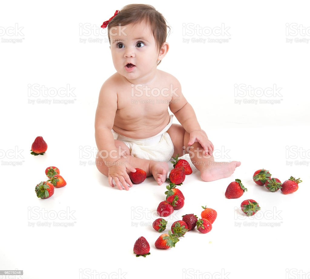 Baby and strawberries royalty-free stock photo