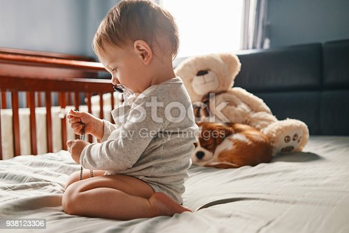 istock baby and the puppy 938123306