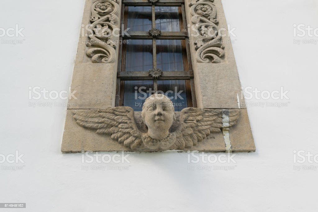 baby angel window frame and decoration detail stock photo