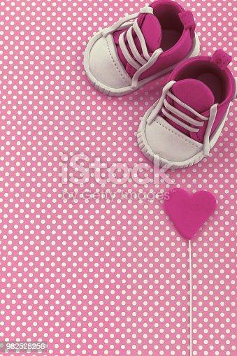 886700726istockphoto Baby announcement. Newborn background. Fondant accesories 982528256