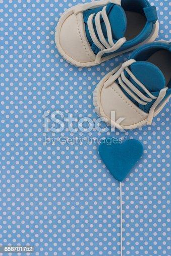 886700726istockphoto Baby announcement. Newborn background 886701752