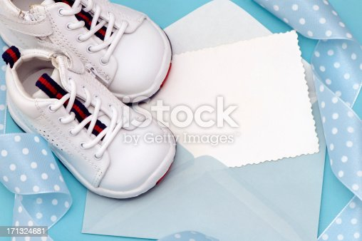 Baby Shoes with Blue Ribbon on white Background.See more: