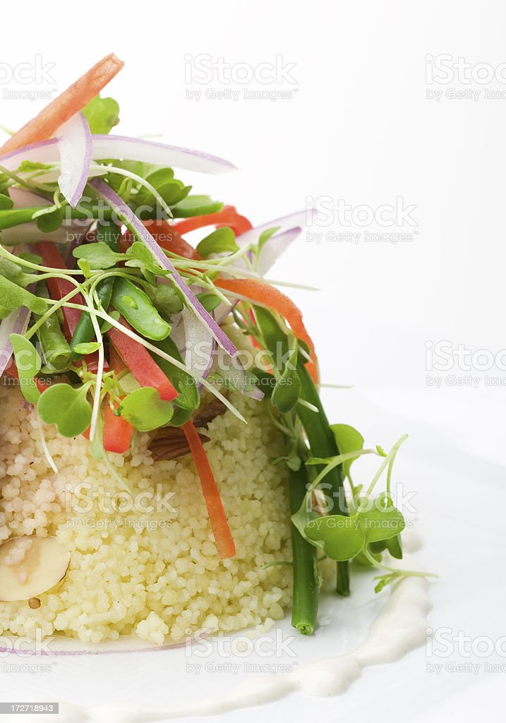 baby arugula salad with almond couscous royalty-free stock photo