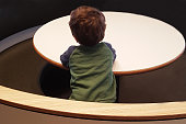 A baby at a round table