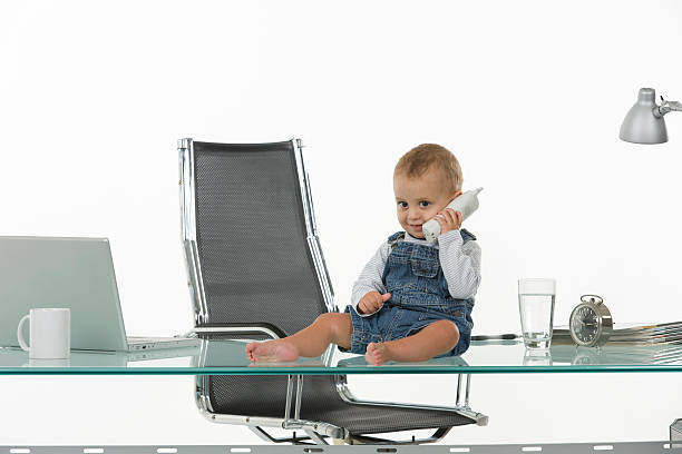 Baby at office stock photo