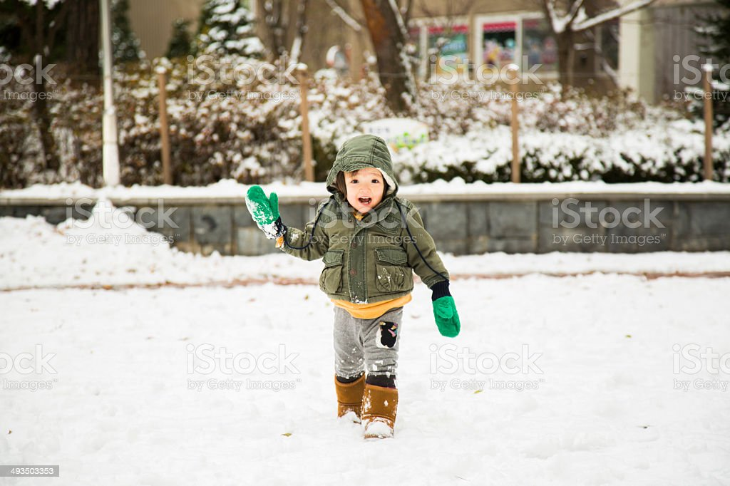Baby At Playground In The Snow stock photo