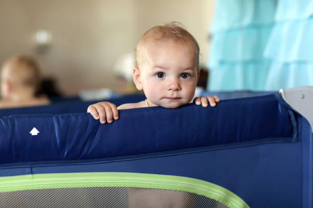 baby at playpen - playpen stock pictures, royalty-free photos & images