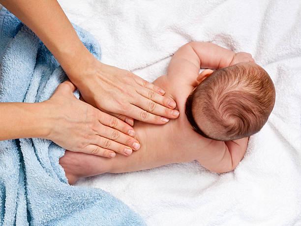 Baby back massage stock photo