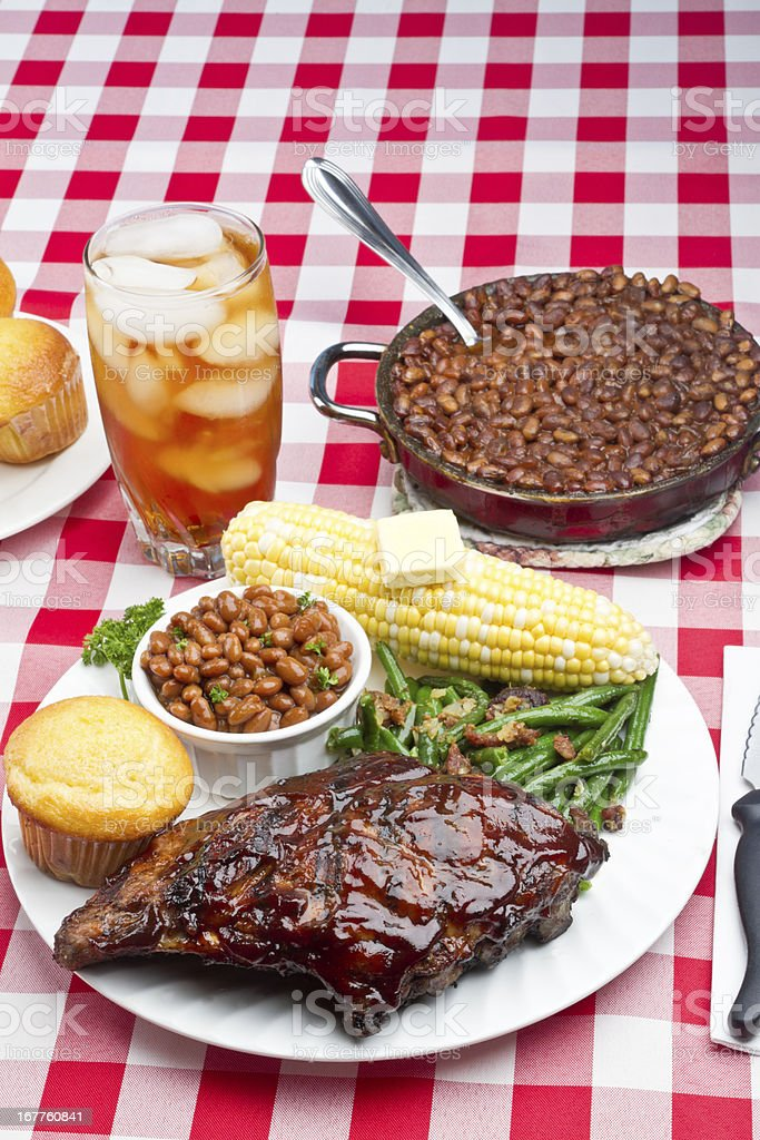 Baby Back Pork Ribs, Baked Beans, Corn on the Cob royalty-free stock photo
