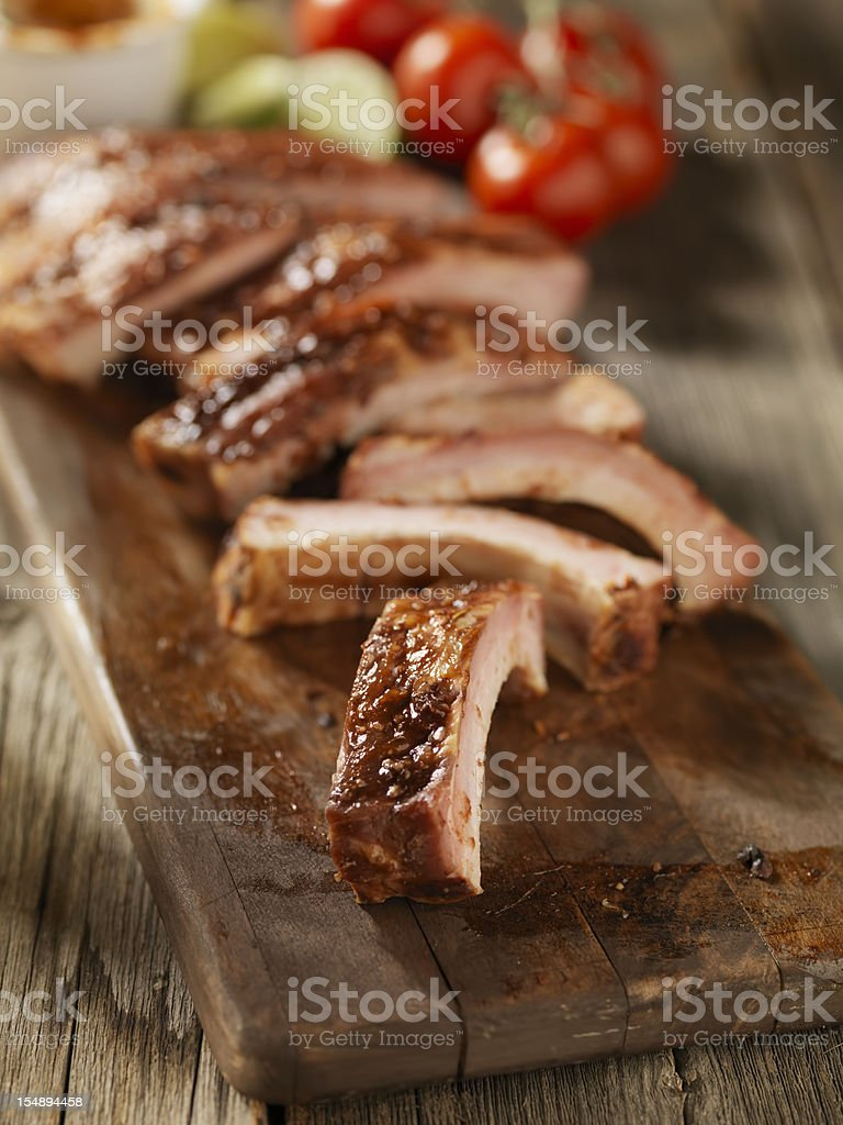 Baby Back Pork Ribs on a Cutting Board royalty-free stock photo