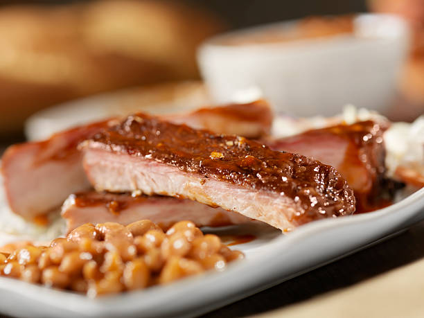 Baby Back Pork Ribs With Baked Beans stock photo