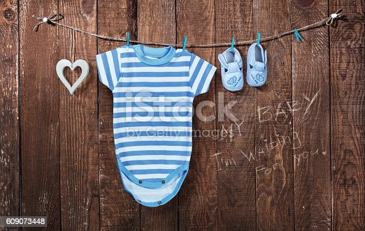 istock Baby background. Baby clothes hanging on the clothesline 609073448