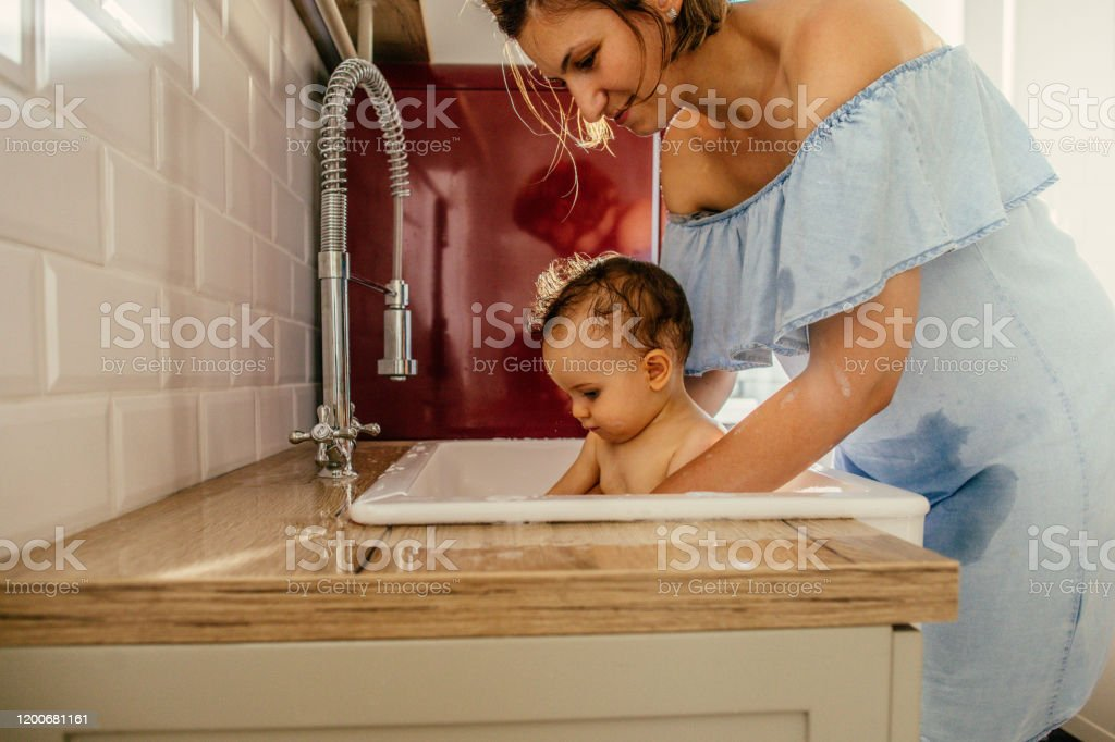 Baby Bath In A Kitchen Sink Stock Photo Download Image Now Istock