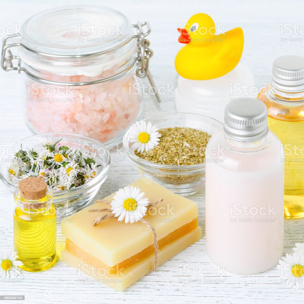 baby bath with chamomile oil, flowers, soap, salt and organic cosmetics, square stock photo