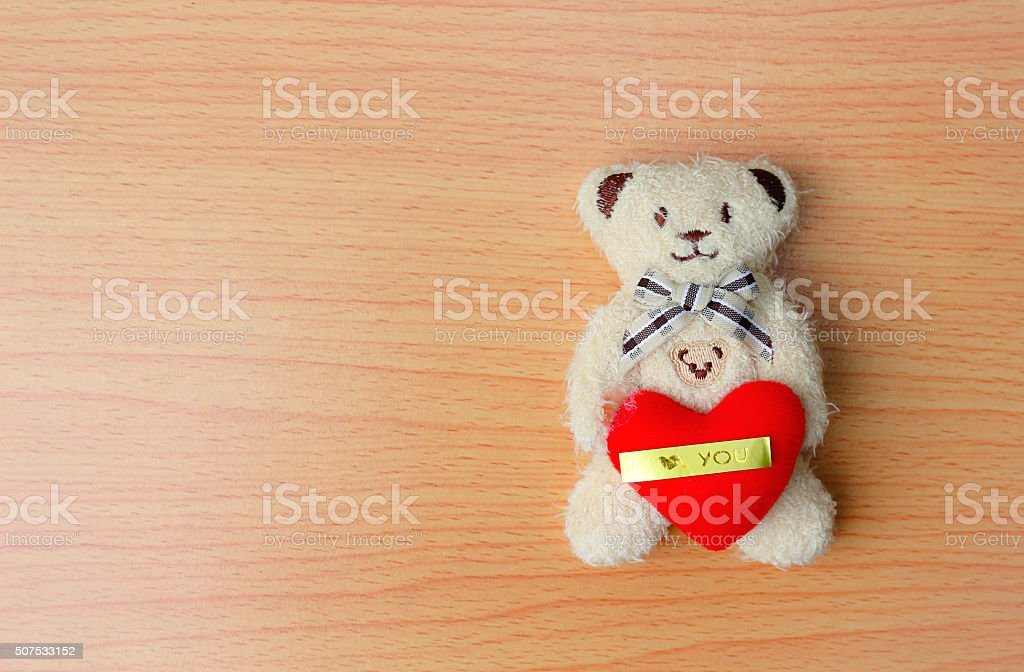 Baby bear and red heart stock photo