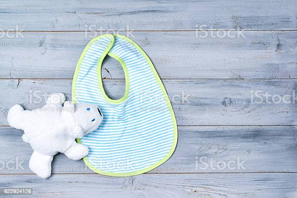 Baby bib and white toy bear on wooden background picture id622924126?b=1&k=6&m=622924126&s=612x612&h=8gawqoxxr5ga78yy35xqn6x2d3kxmrum0ouvjl5zp68=