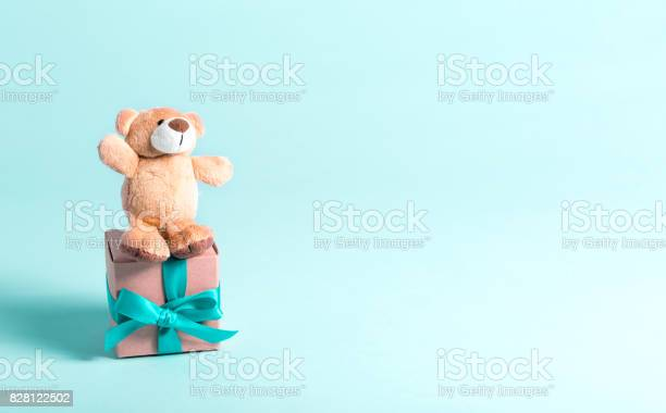 Baby birthday theme with teddy bear and present picture id828122502?b=1&k=6&m=828122502&s=612x612&h=4fpaw xe7vqqrwyx7magt u3ul qv5hbhzkh8wqduqq=