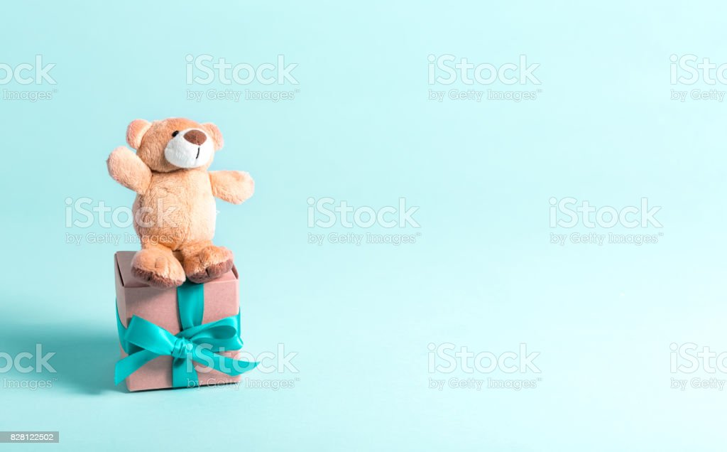 Baby birthday theme with teddy bear and present stock photo