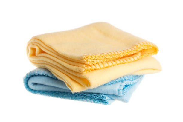 Baby Blankets Yellow and blue soft receiving baby blankets, isolated on a white background. baby blanket stock pictures, royalty-free photos & images