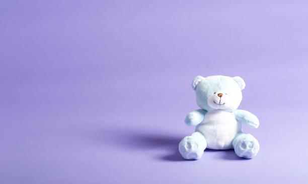 Baby blue childs teddy bear on a purple background picture id865990202?b=1&k=6&m=865990202&s=612x612&w=0&h=1yczs8skxhsocnuvozsw 2o0nkfcpj0dhcfyl7t zzg=