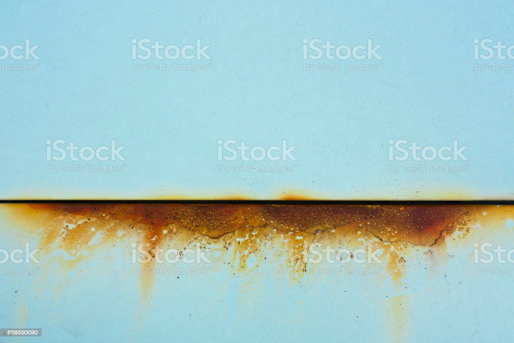 Baby blue metal with rusty cut stock photo