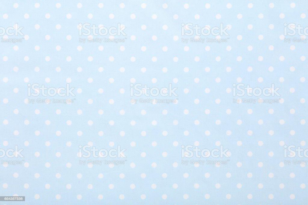 Baby blue polka dot fabric texture background stock photo