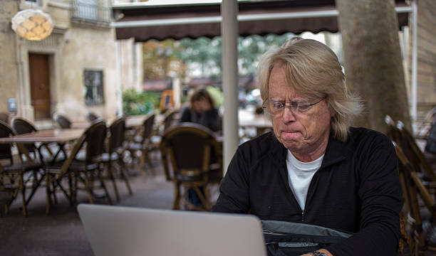 Baby boomer concentrating stock photo
