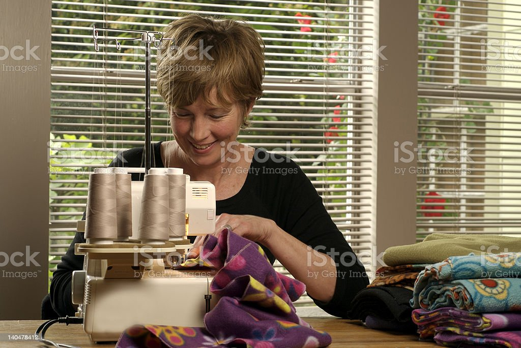 Baby Boomer Sewing at Home royalty-free stock photo