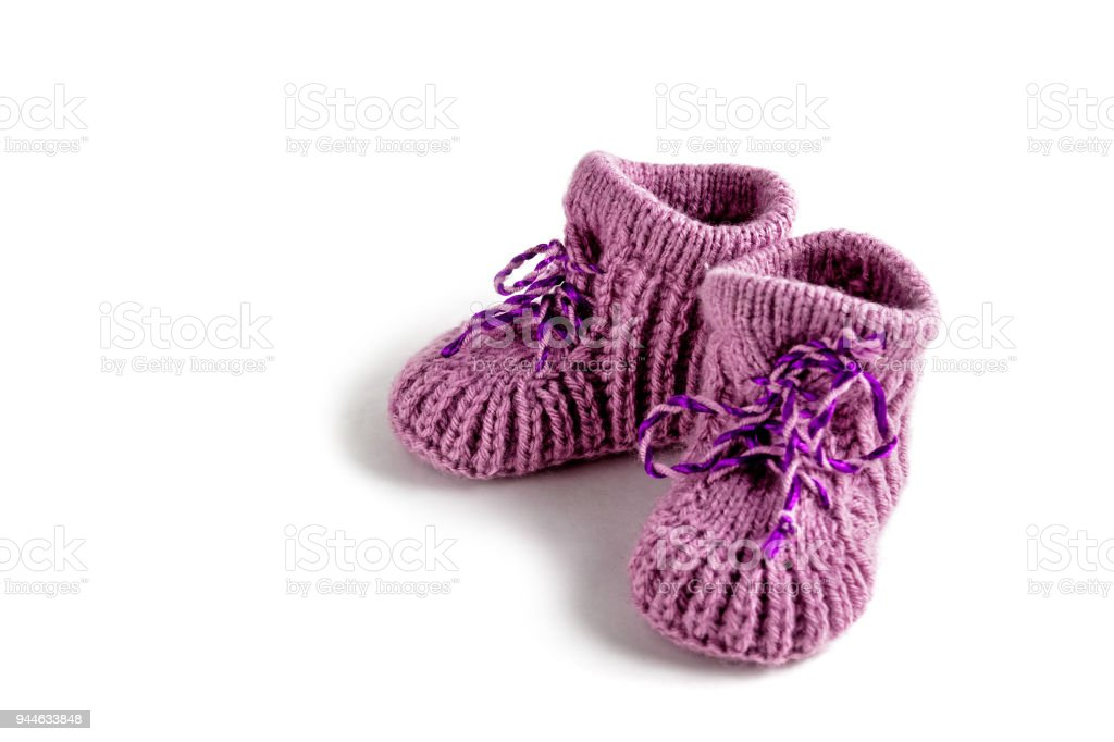 Baby booties on white background. Knitted. stock photo