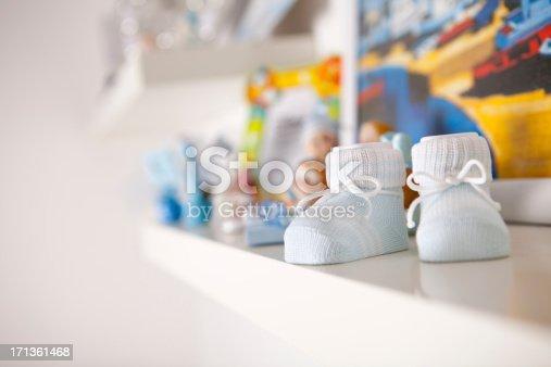Baby booties on shelf.