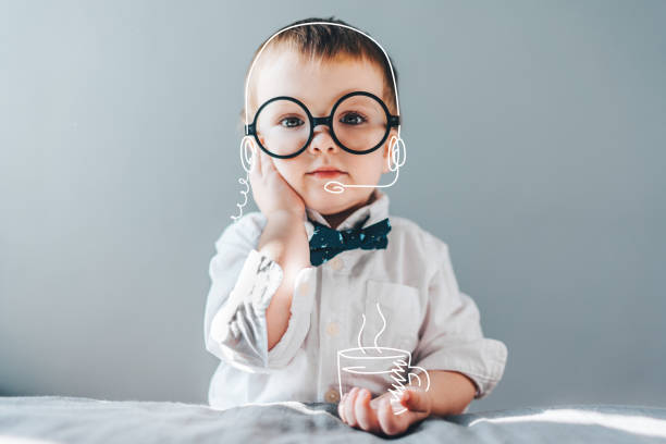 Baby boss Cute little genius. Baby boy wearing smart outfit and eye glasses working as call center operator answering several people and drinking imaginery coffee. Children and technologies concept. cartoon and kids stock pictures, royalty-free photos & images