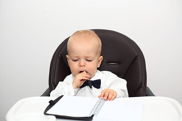 Baby boss thinking stock photo