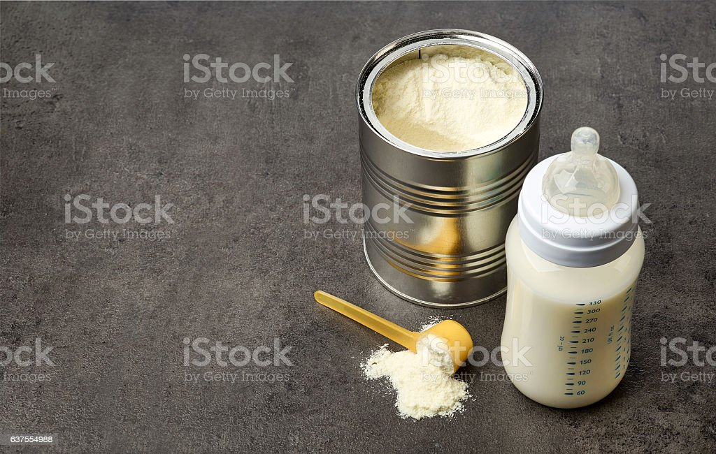 Baby bottle and milk powder stock photo