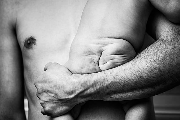 Baby Bottom in Fathers Arms stock photo