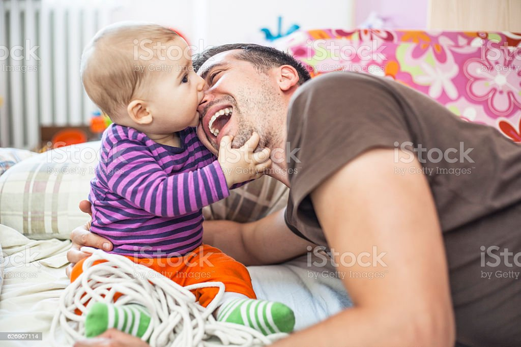 Baby boy and daddy playing stock photo