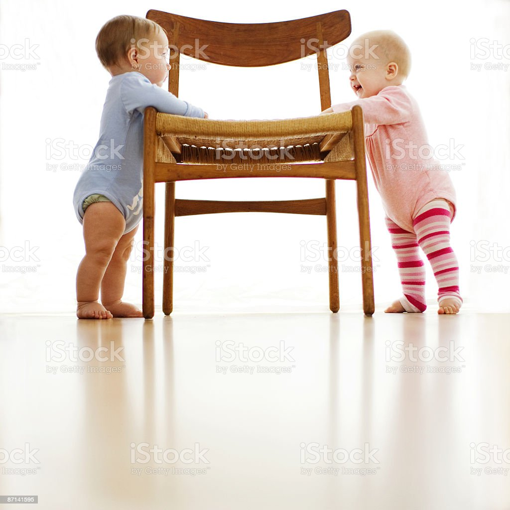 Baby boy and girl looking one another royalty-free stock photo