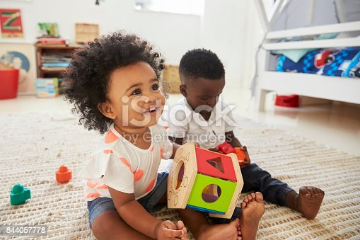 istock Baby Boy And Girl Playing With Toys In Playroom Together 844057778