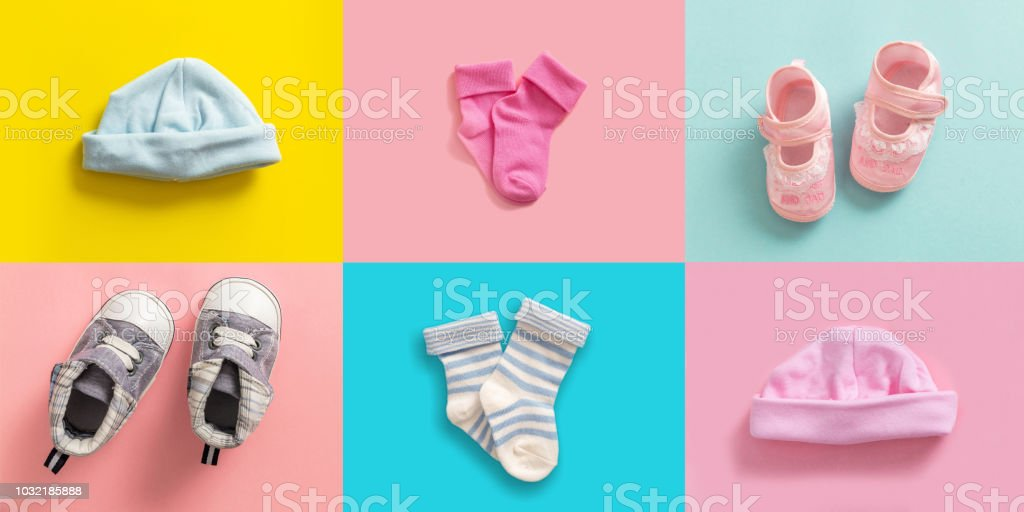 Baby boy and girl shoes and socks collage, pastel colored background stock photo