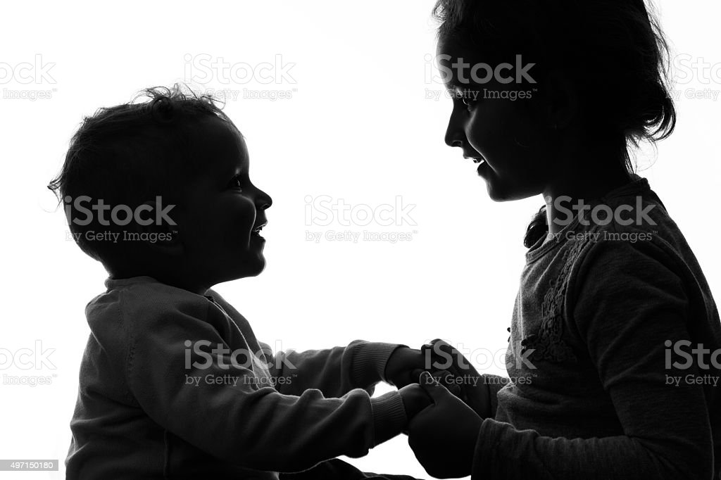 Baby boy and girl silhouette over white background. stock photo