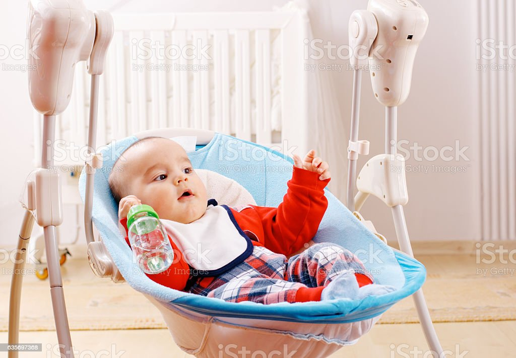 Baby boy and water from bottle stock photo