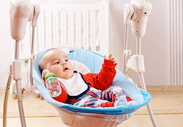 baby boy and water from bottle - balouço imagens e fotografias de stock