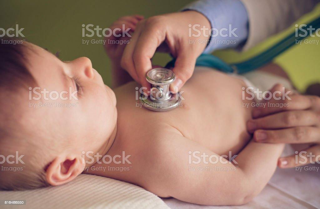 Baby boy at medical exam stock photo