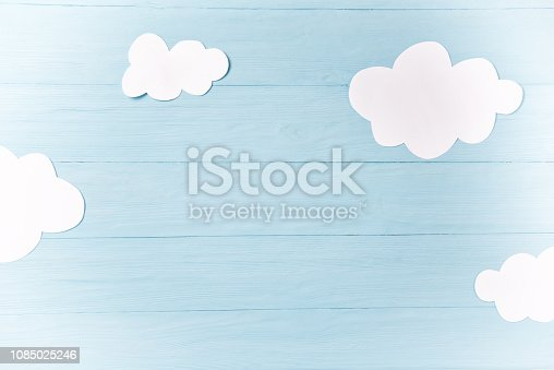 1090975842 istock photo Baby boy background, white clouds on the blue wooden background 1085025246