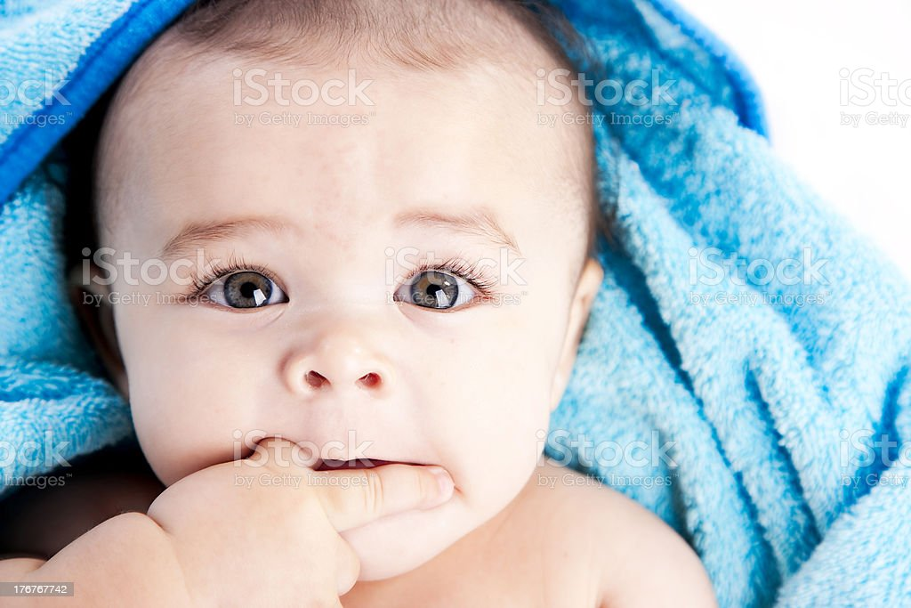Baby Boy Chews on His Fingers Closeup stock photo