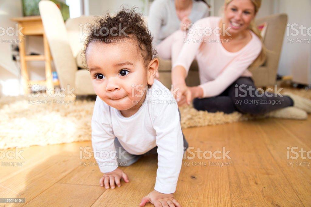 Baby boy crawling at home stock photo