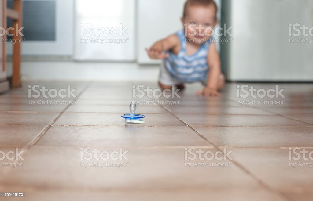 Baby boy crawling. Hygiene at home with babies concept stock photo