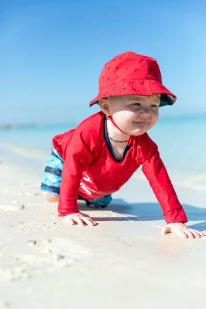 Baby Boy Crawling in the Sand on Tropical Beach, Cayo Coco, Cuba stock photo